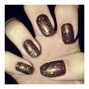 Golden glittered nails.