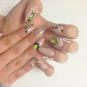 Nude nails with neon and stiletto