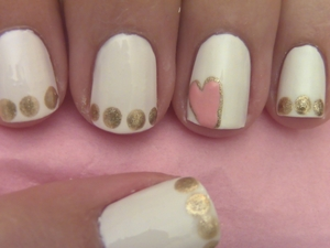 Wear your heart on your nails! This design is really simple to do and super cute.  Have fun with this one girls!  Watch Tutorial: http://www.polishpedia.com/heart-nail-art.html