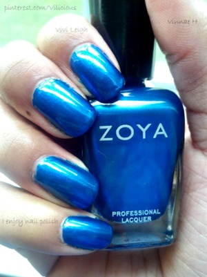 This is two coats of Zoya Tart <3 A vibrant medium blue-raspberry candy blue with soft metallic shimmer.