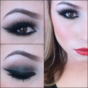 Black smokey eye paired with a bold red lip.