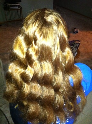 My sister has beautiful red, extremely thick, naturally curly hair. She let me blow dry it and curl it :D