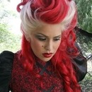Red and blonde curled updo