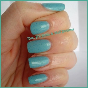 """this is a """"mood potion"""" which changes from blue to green with your body heat.  This is Caribbean Cove in it's cold state.  A robin's egg/aqua blue with fine teal holo glitter throughout."""