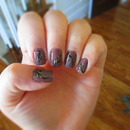 Purple, gold, and black feather nails