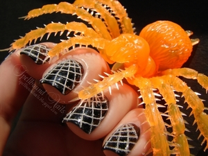 Spiderwebs created with white sewing thread. http://spellboundnails.blogspot.com/2012/10/the-webs-we-weave.html