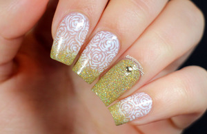 More info + tutorial here: http://www.lacquerstyle.com/2013/11/negative-space-rose-nails-tutorial.html