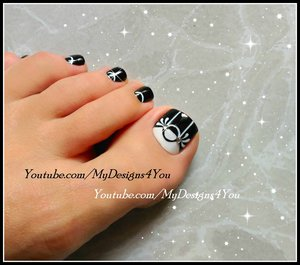 Black and white toenail art.