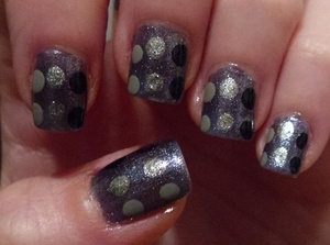 "Here is a different color combination of ""mod"" polka dot nail art"