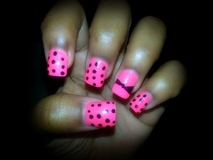 Hot pink base color with black polka dots and an attempted bow :P