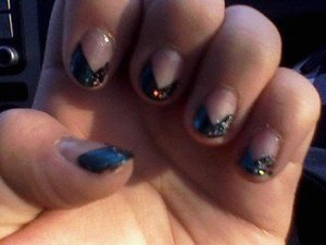 blue and black with sparkles! idk what to call the tip i did?