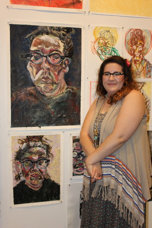 I'm standing in front of and completely blocking (Oh no!) an oil painting triptych self portrait and more drawing/watercolor self portraits- I could post those if anyone wants to see them! My school purchased the smaller self portrait under the larger one, for their permanent collection! :D