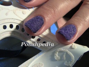 These nails are velvet nails done with flocking powder.  I loved doing them and even created a DIY velvet nails video tutorial @ http://www.polishpedia.com/velvet-nails.html