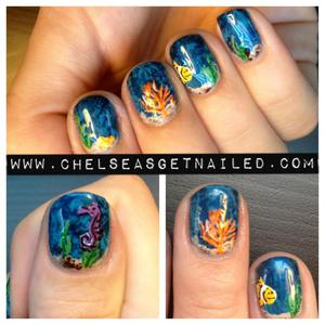 Lately I've been really wanting to head over to the aquarium…so I thought some under the sea inspired nails were in order. To get the water effect, I did some saran wrap nails! And then I hand-painted the rest.  What I Used: -OPI Unfor-greta-bly Blue  -Zoya Robyn -OPI Don't Pretzel My Buttons  -Lechat Nail Art Stripers in Brown, Orange, Purple, Black, Yellow, blah blah blah.