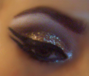 Gold glitter with double winged eyeliner <3