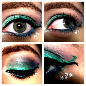 Just a closer up pic of the mermaid inspired makeup. Consists of very cool colors including turquoise, blue, hints of lavender, teal, and shimmery white. I felt that the opposite flaring wings on the end of the eyeliner resembled the tail of the mermaid very well. Looking back, I feel that the white-starred stickers look a little tacky.. But it's alright. ^_^ (P.S - The products I used are in the other mermaid picture that I uploaded, if you were wondering.)