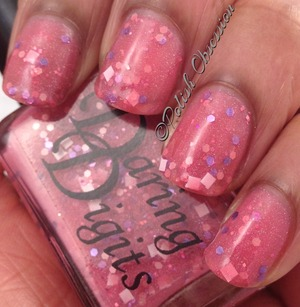 Sheer pink jelly base with pink, fuschia, and purple hex glitter and white square glitter.
