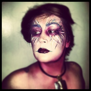 A mixture of face paint, shadows, a liquid liner make up this look I was inspired to do!