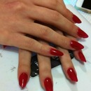 Almond/Stiletto red nails
