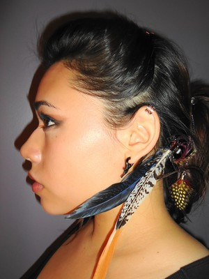 my hair was flat, so i pomp'd it up and stuck feathers in my hair= pocahontas look lol