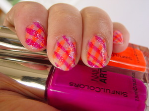 another take with neon colors  i used SinfulColors Nail art in Sour grapes and Orange Alert.  as top coat I used Sally Hansen Extreme Wear in Disco Ball http://youtu.be/g8gfX_wvKx0