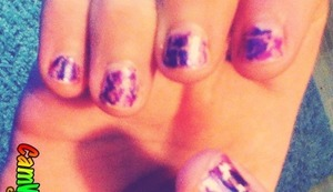 I used a sparkles pearl color and put a thin coat of purple crackle on top
