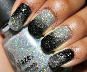 ♥_♥ Such a gorgeous combination! I wore this mani for about 9 or 10 days, and I enjoyed every second of it! Definitely going to be doing this one again. I did this look using two nail polishes & a makeup sponge. The silver was China Glaze Glistening Snow & the black was Zoya Storm. ♥♥♥
