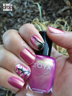 "I used Zoya ""Reece"" for the base. Gradient index finger using Orly ""Luke"" and Wet N Wild ""Ebony Hates Chris"". The accent nail for the blossoms also includes Kiss Nail Art Paint in black. 
