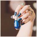 Blue glitter nails.