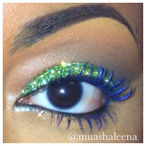 I used green glitter from Ben Nye all over my lid. I used a dark brown in my corner crease. The blue mascara is from maybelline. It was their limited edition blue mascara which I think is not sold anymore :( But so many other brands have blue mascara!