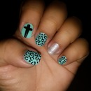 Animal print/cross nails.