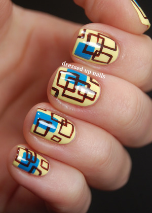 Based on an image I found on AllPosters.com. Blog post has image link & description of how I did them!  http://www.dressedupnails.com/2013/02/geometric-challenge-day-1-square.html
