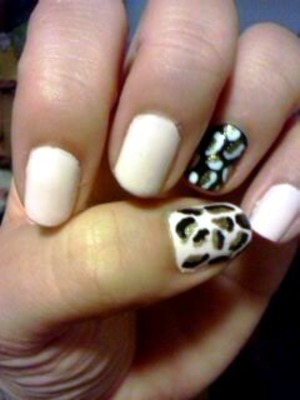 sinful colors in easy going,  a black nail polish, a white nail Polish and a gold nail Polish