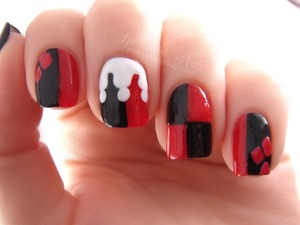 Jester nails inspired by Harley Quinn. http://spellboundnails.blogspot.com/2012/11/j-is-for.html