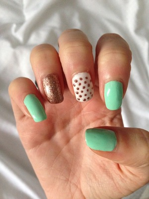 Mint green shellac, with gold glitter nail and a white nail with gold glitter dotting... Love!
