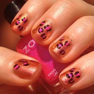 Leopard print nails á la Modnails using Glitter Gal Fiery Furness as a base coat, Serpent Black for the C shapes, and Zoya Lola for the dots  http://michtymaxx.blogspot.com.au/2013/01/leopard-print-nails.html
