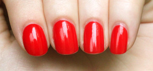 A perfect orange-red. Two coats for opacity. Please excuse the tip wear, this is the third day I've had it on. :]