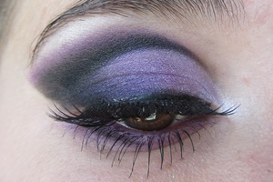 Basically I was really mesmerized by the look of a cut crease at the time but it seemed nearly impossible to me that I could achieve it. Well, I tried it for the first time here and I have to say I don't think I did too bad but I definitely have some improving to do. This is a pretty bold look and the purple really does bring out my brown eyes, it isn't my favorite look that I've done but since it was my first shot at a cut crease I thought I should publish it for you all. Oh and a lot of the looks I have done are only on one eye for my own convenience(laziness) but there is one with a full face too. Hope you like it! And don't worry, this isn't the last of me!  The Products Used:  -Urban Decay Primer Potion in Original Lid(Base)-Maybelline 24 hr Color Tattoo in Painted Purple Lid/Lower Lash Line-bh Cosmetics 120 Palette (various different purple shades) Crease-Maybelline Gel Liner in Blackest Black Crease Blended-Urban Decay Eye Shadow in Perversion Above Crease-Urban Decay Psychedelic Sister Tear Duct/Brow Bone-NYX Pearl Mania Eye Shadow in White Pearl Inner Corner-NYX Cosmetics Eye Shadow in Frosted Lily Water Line-Urban Decay 24/7 Glide-On Eye Pencil inn Ransom Top Lash Line/Lower Lash Line-Maybelline Gel Liner in Blackest Black Eye Liner Blended with-Urban Decay Eye Shadow in Perversion Eye Lashes-Cover Girl LashBlast Volume in Very Black Falsies- NYX False Lashes in Nostalgia