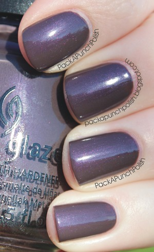 China Glaze Jungle Queen is a greyed out purple with subtle pink and purple shimmer. This is part of the On Safari Collection. This is 2 coats without topcoat. It is also similar to Chanel's Paradoxal, but it's not an exact dupe!  Full Blog Post: http://packapunchpolish.blogspot.com/2012/11/china-glaze-jungle-queen.html