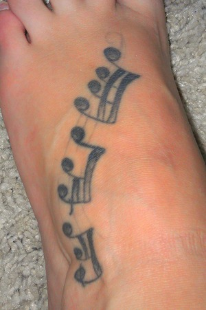 My tattoo on my foot! Its of my favorit song!