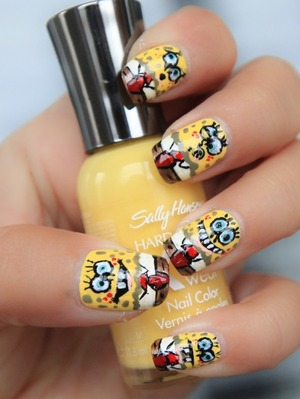 more photos here: http://littlebeautybagcta.blogspot.ro/2012/09/cartoon-nails-sponge-bob.html