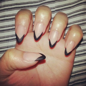 nude and black stiletto nails.