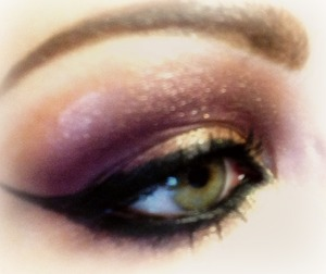 Smokey cut crease look in gold and plum. Brings out green eyes nicely.