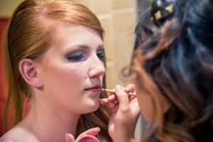 Finishing touches to the beautiful bride.