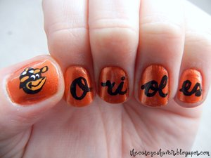 http://thecateyeshaveit.blogspot.com/2012/02/christys-orange-nails-take-two.html
