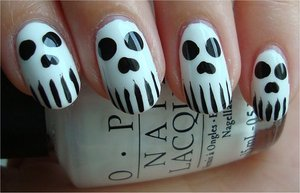 Nail tutorial & more photos here: http://www.swatchandlearn.com/nail-art-tutorial-skull-nails/