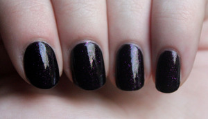 Wet N Wild Wild Shine in Night Prowl. Basically, it's Revlon's Scandalous but only with the microglitter. I prefer this one. :]