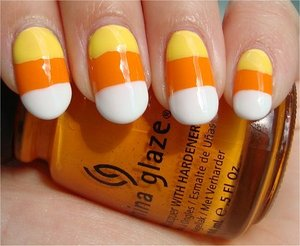Nail tutorial & more photos here: http://www.swatchandlearn.com/nail-art-tutorial-candy-corn-nails/