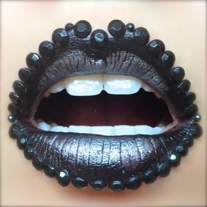 Here's some fierce and glitzy lip art fit for Gaga or at least would elicit a shriek or two from the general public. I love dark lip looks and wanted to break out the chunky rhinestones and OCC Tarred. The contrast between Tarred and Sugarpill's Tiara works so well to bring dimension to the design.  http://michtymaxx.blogspot.com.au/2013/02/black-diamond.html