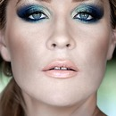 Blue-green smokey eyes.